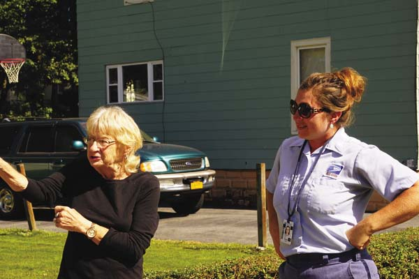 Judi Gosselin, left, talks about her experience after she lost consciousness and mail carrier Nicole Hunt, right, found her face down in her driveway. (Photo submitted)