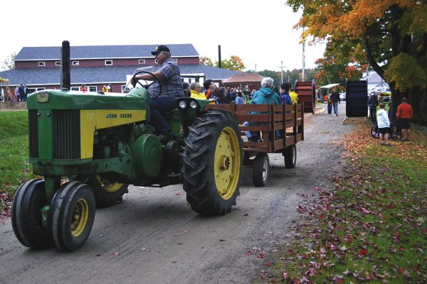 Volunteer Tom Eriksen of Root leads guests on wagon rides at the Fall Festival at Sacandaga Bible Conference in October 2016. The seventh annual festival will be held Saturday at the camp on Lakeview Road in Broadalbin. (Photo submitted)