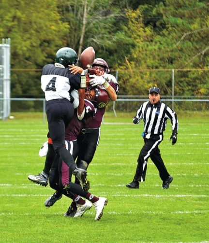"""Gloversville's William """"Buck"""" Galster and Trevor Mee break up a pass play intended for Green Tech's Rayshawn Dukes (4) during a Class A game last Saturday afternoon at Robert E. Gould Stadium at Husky Field in Gloversville. (The Leader-Herald/James A. Ellis)"""