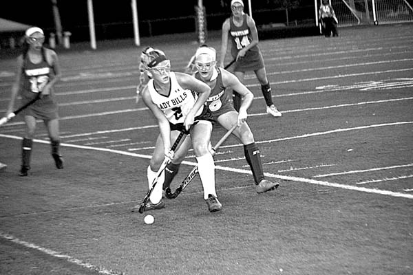 Johnstown's Molly Lake (2) looks to pass as Queensbury's Chloe Liles defends during Thursday's Foothills Council field hockey game at Knox Field in Johnstown. (The Leader-Herald/Paul Wager)