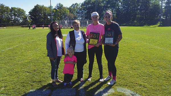 Pictured, from left, are Saxy Marshall's great-granddaughter, Elizabeth Grich, Marshall's great great-granddaughter,  Piper Wilson. Marshall's daughter, Kathy Grich, Kendra Lavery (Defensive Player of the Game) and Kerri Hauser (Offensive Player of the Game). (Photo submitted)