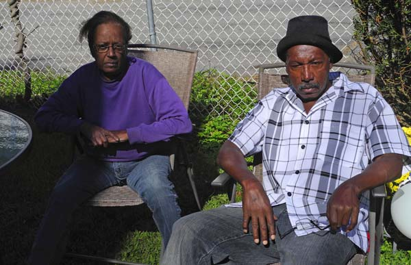 Left to right, cousins Margo Reid of Johnstown and Doren Gray Sr. relax recently in the backyard of Gray's home on South Judson Street in Gloversville. (The Leader-Herald/Michael Anich)