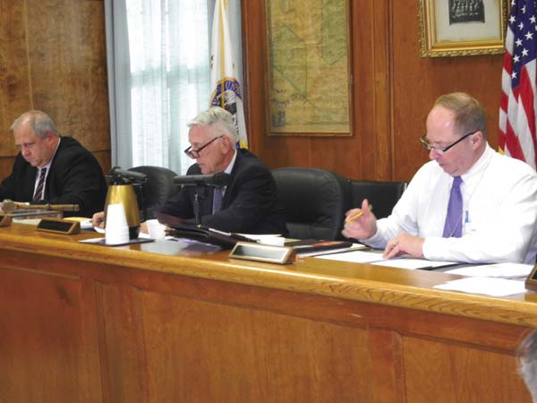 Fulton County Administrative Officer Jon Stead leads the Board of Supervisors through approval of resolutions at the board meeting Tuesday at the County Office Building in Johnstown. County Attorney Jason Brott is at the far right and board Chairman Mike Kinowski is in the center. (The Leader-Herald/Michael Anich)