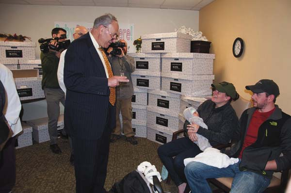 Sen. Charles Schumer talks with new parents, Jessica and Derek Hermann and baby Amelia, as he learns about the Nathan Littauer Baby Box program. Amelia was born Oct. 4. Photo submitted