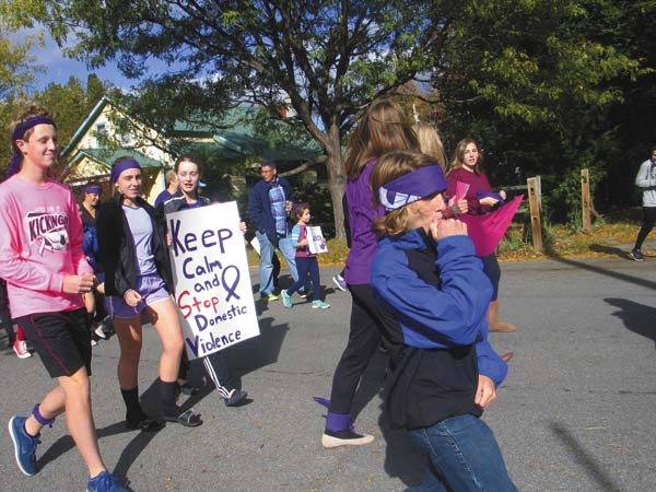 Students, parents and faculty of Northville Central School District take part in Students Against Destructive Decision's. SADD had its first annual domestic violence walk in Northville on Monday. (The Leader-Herald/Briana O'Hara)