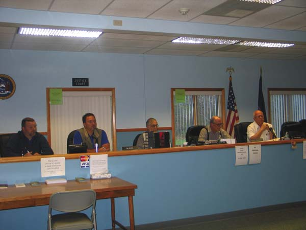 Town of Johnstown councilmen, from left, Donald, VanDeusen,Timothy Rizzo, Walt Lane, Daryl Baldwin, and  Jack Wilson, right discuss the 100 percent tax raise with citizens at the board meeting on Monday at the Town Hall. (The Leader-Herald/Briana O'Hara)