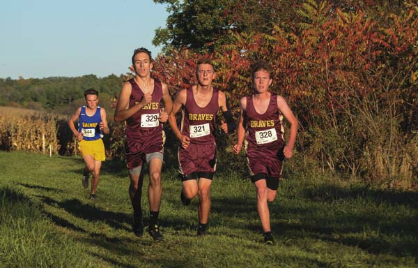 Fonda-Fultonville's Aiden Zenzen (329), Shane Viscosi (328) and Myles Anderson (321) lead Galway's Holden Decker during Tuesday's Western Athletic Conference cross-country meet at Sand Flats Orchard in Fonda. (The Leader-Herald/James A. Ellis)