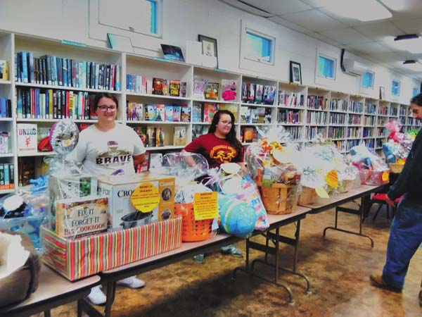 Frothingham Free Library patrons look at baskets for its Taste of Chocolate & Basket Fundraiser which will be held at St. Cecilia's Church Hall, 26 Broadway in Fonda, on Saturday at 6 p.m. (Photo submitted)