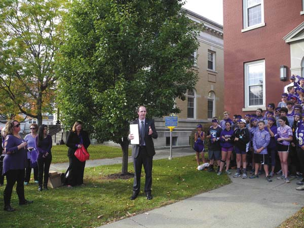 Fulton County District Attorney Chad Brown, center, on Thursday speaks during a ceremony denoting Domestic Violence Awareness Month in front of the Tree of Hope outside the Fulton County Courthouse in Johnstown. (The Leader-Herald/Michael Anich)