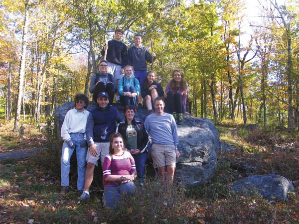 The Broadalbin-Perth High School's Adirondack Humanities class taught by Dan Simonds and Anthony Mucilli pose in photo along with local author Heidi Sprouse at the top of Kane Mountain on Wednesday. (The Leader-Herald/Briana O'Hara)