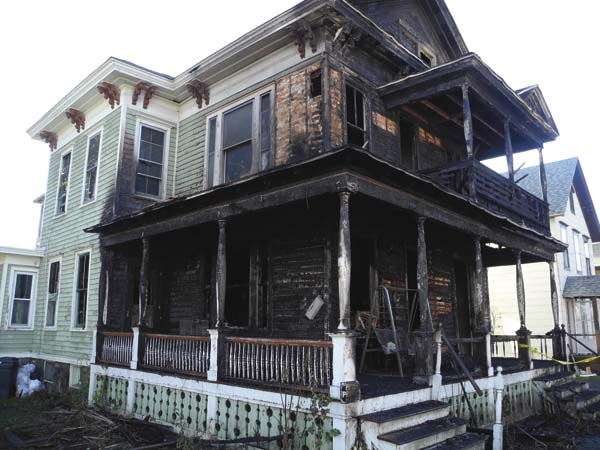 The home at 25 Grand St. in Gloversville badly destroyed by fire Friday morning is seen Friday afternoon. (The Leader-Herald/Michael Anich)