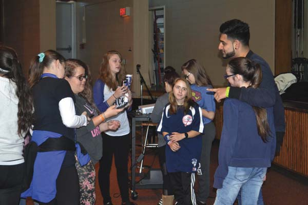 Wali Shah takes pictures with students following his talk at Gloversville High School on Friday. (The Leader-Herald/Kerry Minor)