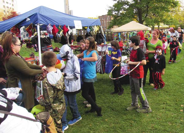 Youngsters line up in costume to get treats from the vendors Saturday during the Fall Fest at the Rail Trail Park sponsored by the Gloversvile Recreation Commission. (The Leader-Herald/Eric Retzlaff)