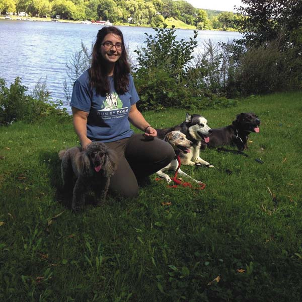 In this undated photo, Kate Walrath poses with some of her dogs. (Photo submitted)