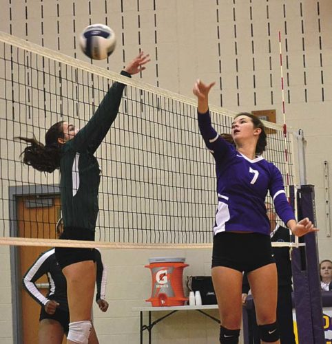 Johnstown's Alexys Hutchins (7) and Hudson Falls' Moira Hogan battle at the net during Wednesday's Section II semifinal match at Voorheesville High School. (The Leader-Herald/Paul Wager)