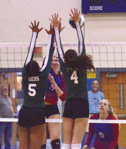 Hudson Falls' Naesha Kelley (5) and Moira Hogan (4) go up for a block against Broadalbin-Perth's Cassy Bown during Friday's Section II Class B championship match at Saratoga Springs High School. (The Leader-Herald/James A. Ellis)