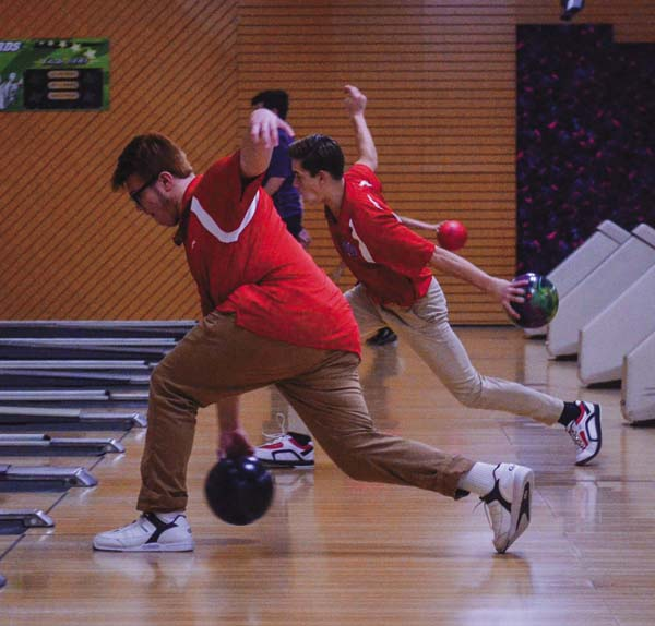 Broadalbin-Perth's Zach Rinehart, front, and Jared Eipp warm up for the Patriots' season-opening match against Amsterdam Wednesday at Imperial Lanes in Amsterdam. (The Leader-Herald/James A. Ellis)
