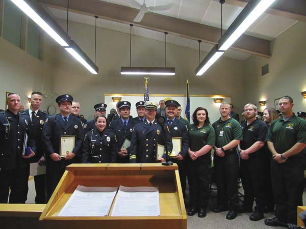Members of the Gloversville Police Department, Gloversville Fire Department, Johnstown Fire Department and Ambulance Service of Fulton County were recognized on Tuesday for their work in saving several people from an October fire on Grand Street. (The Leader-Herald/Kerry Minor)