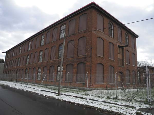 The site of the former Diana Knitting Mill at North Perry and Grove Streets in Johnstown,  which Townsend Leather wants to rehabilitate, is pictured Monday. (The Leader-Herald/Michael Anich)