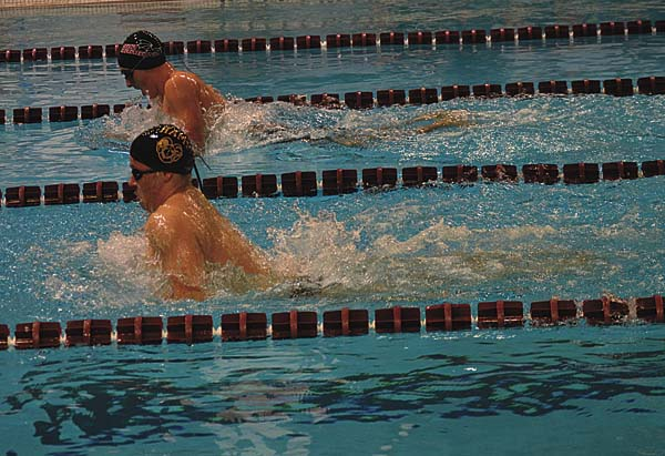 AmsterdamÕs Thomas Knack, foreground, and GloversvilleÕs Jacob Sweeney battle during the breaststroke leg of the 200-yard medley relay in ThursdayÕs Foothills Council boys swim meet at Gloversville Middle School. (The Leader-Herald/Paul Wager)