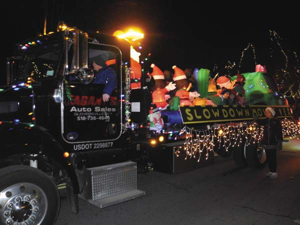 A colorful float travels along the Johnstown Holiday Parade route Friday night. (The Leader-Herald/Michael Anich)
