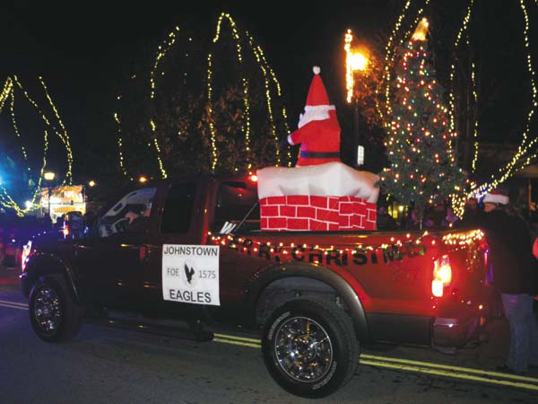 The Johnstown Eagles float travels along the Johnstown Holiday Parade route Friday night. (The Leader-Herald/Michael Anich)