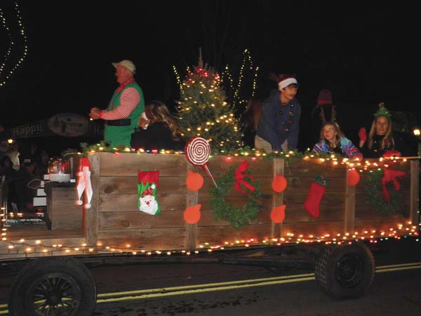 A float travels along the Johnstown Holiday Parade route Friday night. (The Leader-Herald/Michael Anich)
