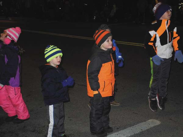 Kids get excited about seeing the beginning of the Johnstown Holiday Parade Friday night in Johnstown. (The Leader-Herald/Michael Anich)