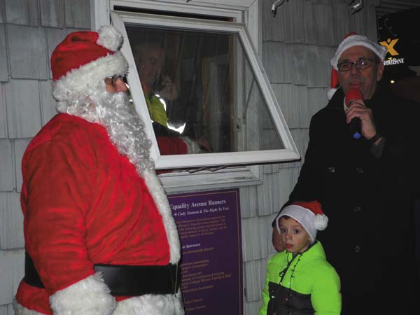Johnstown Mayor Vern Jackson stands with grandson Ian and Santa Claus as they count  down the lighting of the downtown Christmas tree at the Johnstown Colonial Stroll Friday night in the city. (The Leader-Herald/Michael Anich)