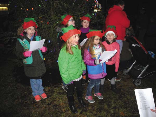 Girl Scouts sing carols at the Johnstown Colonial Stroll Friday night in the city. (The Leader-Herald/Michael Anich)