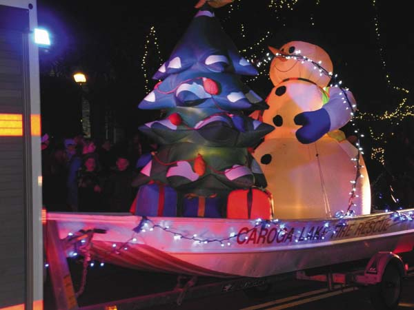 A snowman float graces the Johnstown Holiday Parade Friday night. (The Leader-Herald/Michael Anich)