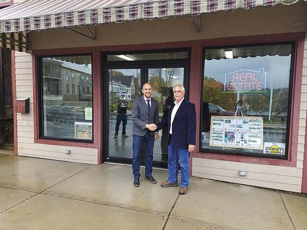 CMK and Associates Real Estate owner and Chief Executive Officer Christian Klueg, left, poses with Van Billings in front of CMKÕs newest office at 14 S. Main St. in Dolgeville. It is the seventh office for CMK, joining existing locations in Northville, Amsterdam, Speculator, Johnstown, Guilderland and Ballston Spa. (Photo submitted)