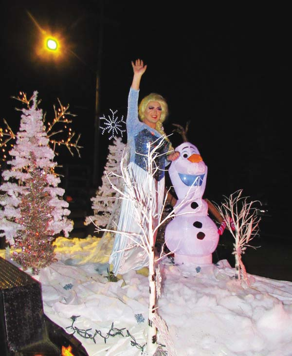 Elsa, a character in the children's movie Frozen, greets the crowd at the Northville Christmas parade Saturday afternoon. (The Leader-Herald/Eric Retzlaff)