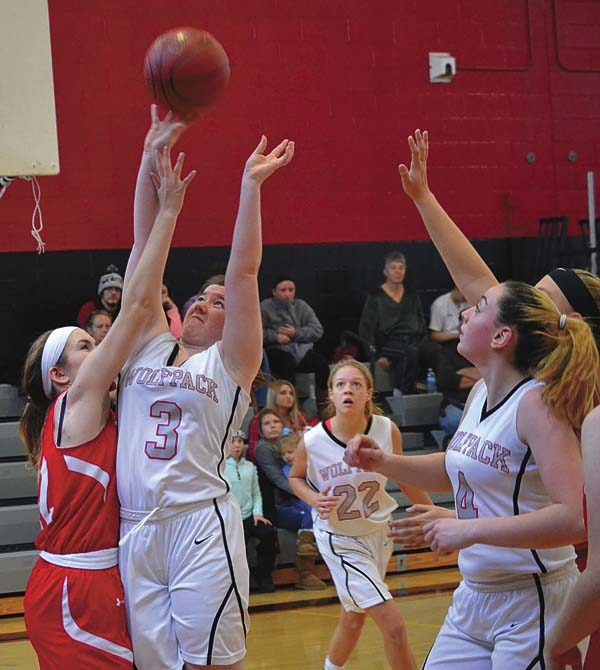 Oppenheim-Ephratah/St. Johnsville's Emma Hart (3) puts up a shot over Wells' Gena Brown during Saturday's non-league game. (The Leader-Herald/Paul Wager)