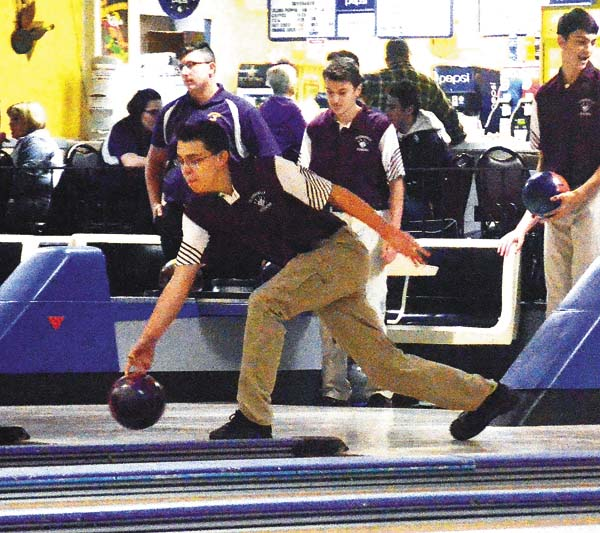 Gloversville's Aiden Carter warms up for the Huskies' Foothills Council match against Johnstown Monday at Arterial Lanes. (The Leader-Herald/James A. Ellis)
