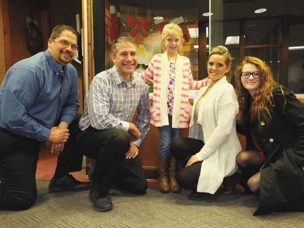 From left are Salvation Army of Fulton County Board Chairman David Karpinski, Mayfield Elementary School Principal Nicholas J. Criscone, Kendyl Conyne with her mom, Stacia and toy drive supply Coordinator Hannah Pitcavage. (Photo submitted)