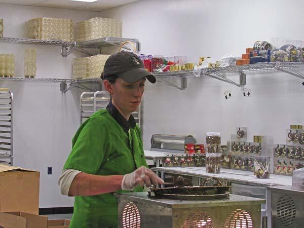 Megan Saltsman works to prepare a batch of treats at EMVI CHocolates in Broadalbin. (The Leader-Herald/Kerry Minor)