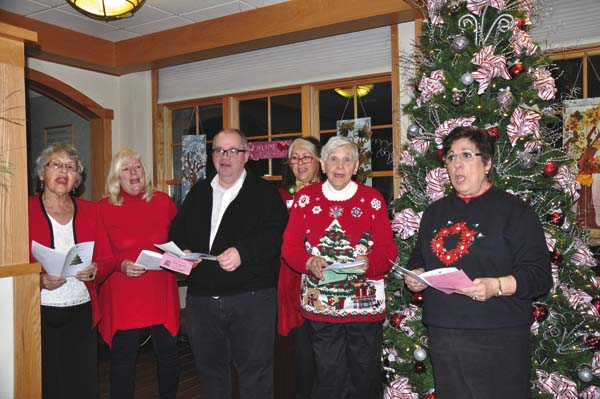 Carol singing from the Nathan Littauer Hospital & Nursing Home auxiliary annual Tree of Lights ceremony held Friday in the Nathan Littauer Hospital lobby. (Photo submitted)