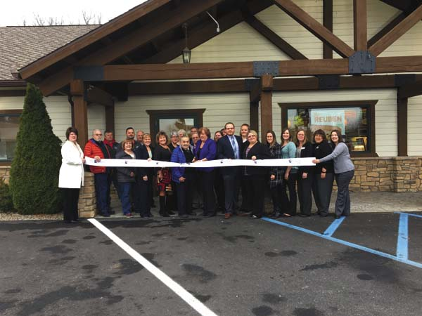 In the ribbon cutting photo are credit union staff members, including President/CEO Brenda Coons holding scissors, credit union board members, management team, staff members, elected officials and their representatives and chamber ambassadors. (Photo submitted)