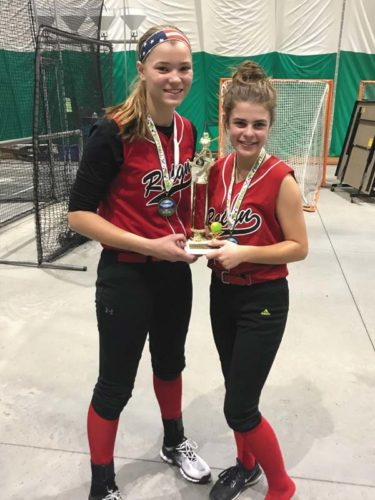 Joelle Bump, left, Grace Giarizzo and their travel softball team, the Rotterdam Reign, won the highly competitive 14U indoor fast-pitch softball tournament Dec. 3, at the Adirondack Sports Complex in Queensbury. (Photo submitted)