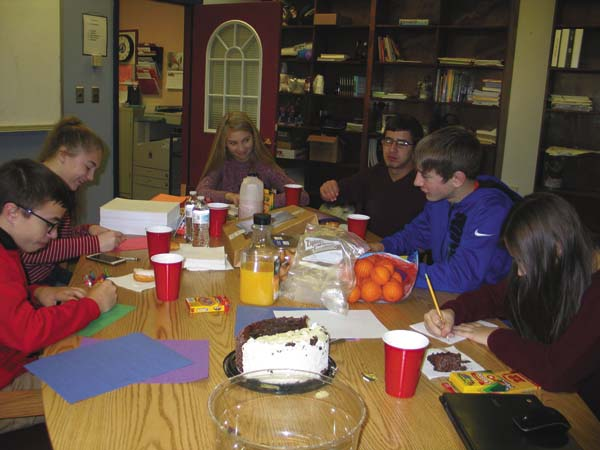 During advisory groups on Friday, Northville High School students create Christmas cards to send to veterans. (The Leader-Herald/Briana O'Hara)