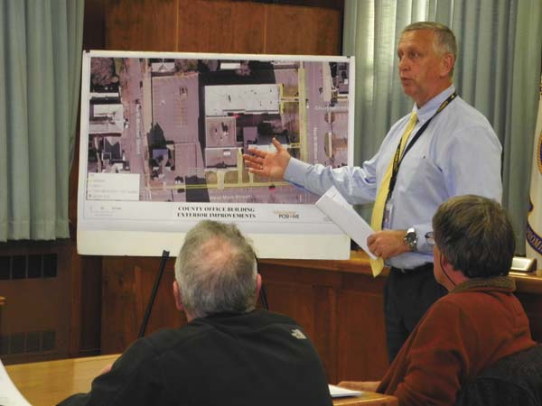Fulton County Planning Director James Mraz, standing, gives a presentation on the County Office Building renovation project to the county Board of Supervisors' Buildings and Grounds/Highway Committee Wednesday in Johnstown. (The Leader-Herald/Michael Anich)