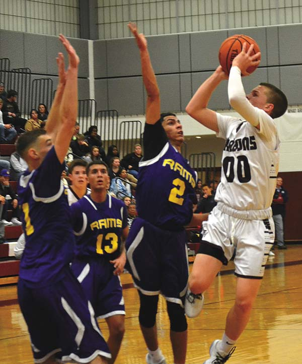 Gloversville's Dante Bouchard (00) shoots over Amsterdam's Deanthony Colon (2) and Louis Fedullo during a Foothills Council game on Dec. 1 at Gloversville High School. (The Leader-Herald/Paul Wager)