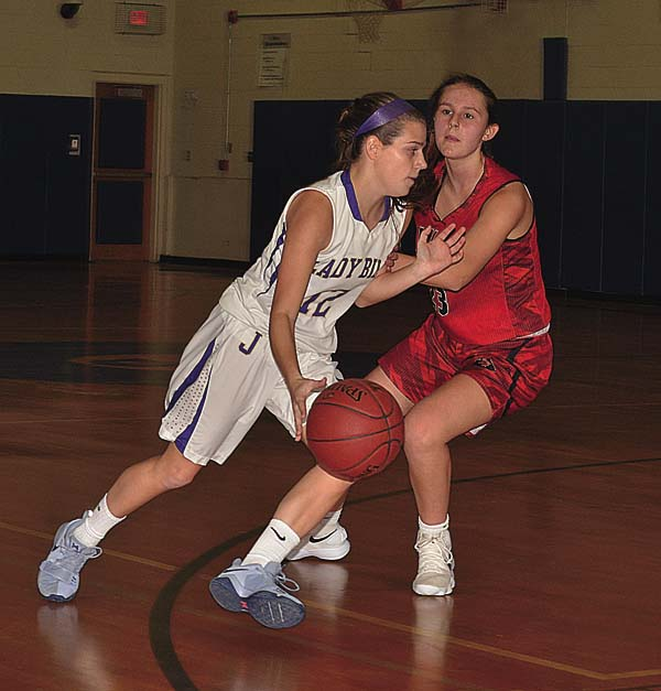Johnstown's Jess VanNostrand (12) drives past Glens Falls' Felicity Williams during Monday's Foothills Council game at Warren Street Elementary School in Johnstown. (The Leader-Herald/James A. Ellis)