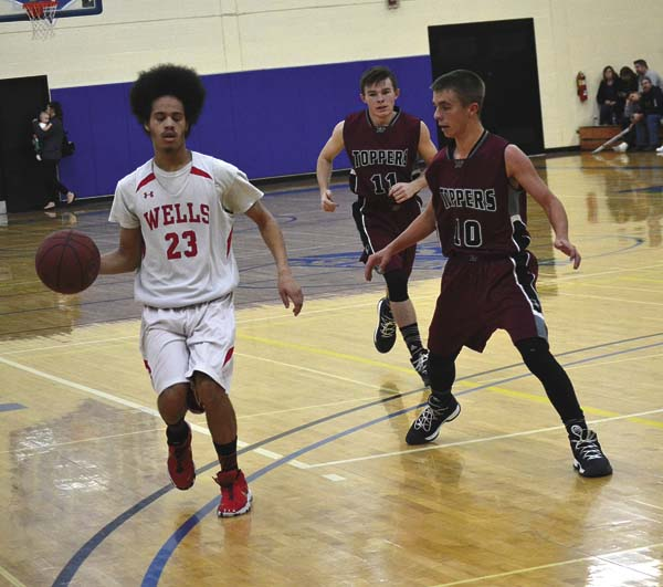 Wells' Tre Zimmerman (23) dribbles past Fort Plain's Jacob Hisert (10) during the Coaches vs. Cancer Tip-Off Classic at Fulton-Montgomery Community College on Dec. 1. (The Leader-Herald/Paul Wager)