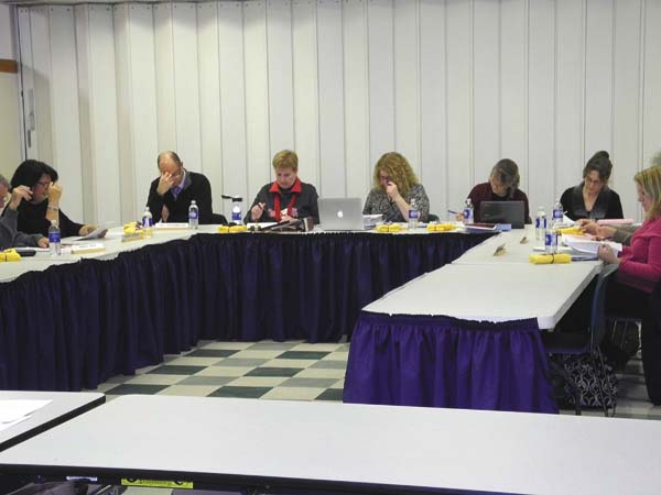 The Greater Johnstown School District Board of Education reviews personnel items Thursday night at Johnstown High School. (The Leader-Herald/Michael Anich)