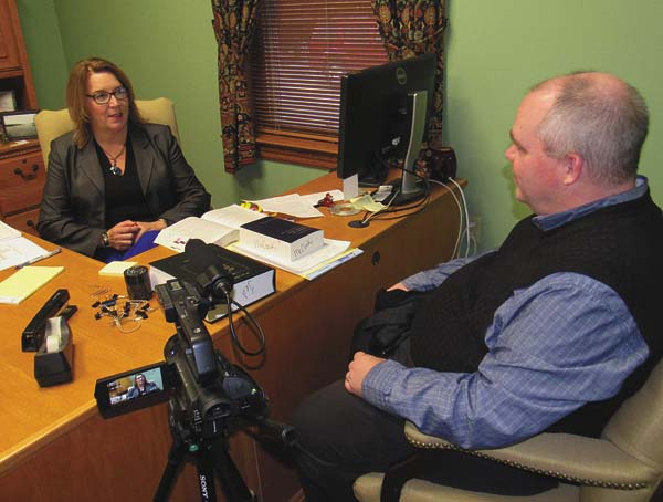 Communication specialist Greg Hitchcock interviews Montgomery County District Attorney Kelli McCoski in her Fonda office for his upcoming multimedia presentation on the area impact of the nationwide opioid-abuse epidemic. (The Leader-Herald/Eric Retzlaff)