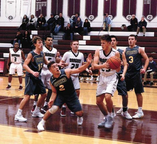 Gloversville's Joey Rowback (23) grabs an offensive rebound away from Queensbury's Patrick Conway (2) during the second quarter of Wednesday's Foothills Council game at Gloversville High School. Looking on are the Dragons Anderson Jones (24) Buck Galster (5) and Esean Brown (3) along with Queensbury's Bryce Bleibtrey (15), Jeff VanAnden (3) and Thomas Scotto-Lavino. (The Leader-Herald/James A. Ellis)