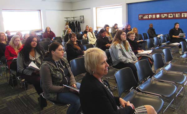 Some 30 people listen to presentations about a new weekend program to train licensed practical nurses combining the resources of Fulton-Montgomery Community College in Johnstown with Maria College in Albany at FM on Thursday. At center forefront is Laura LaPorte, FM associate dean for student recruitment and admission. (The Leader-Herald/Eric Retzlaff)
