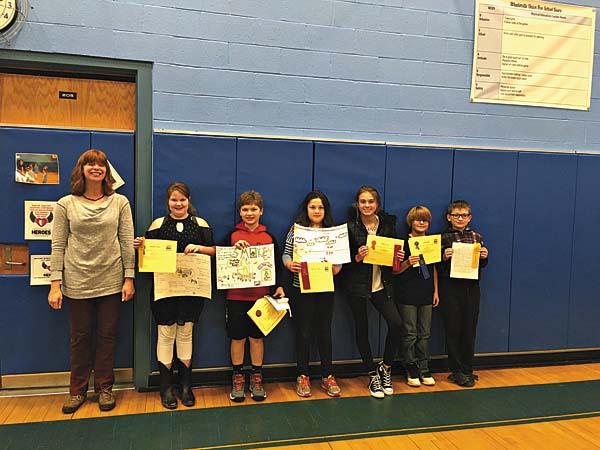 Hamilton County Soil and Water Conservation District's Caitlin Stewart (left) awarded Wheelerville Union Free School's Georgiana Angus, Tavien Blowers, McKenzie Negron, Viktorija Izzo, Logan Smith, and Nicholas Lorenz  certificates and ribbons for their Conservation Field Day posters and essays. (Photo submitted)